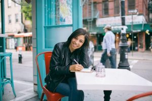 woman sitting at table in downtown
